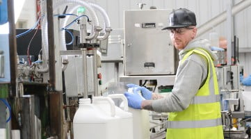 operator in high viz working on a production line.