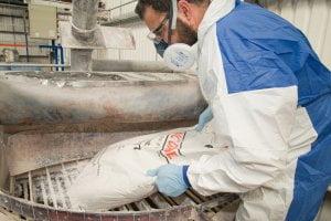powder sack being emptied into blending machine