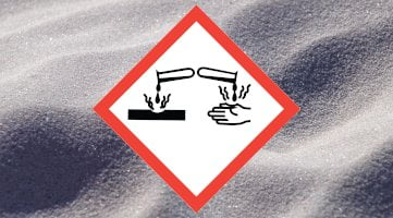 corrosive safety sign with powder background
