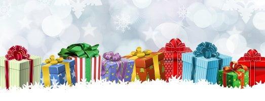 row of christmas presents on snow