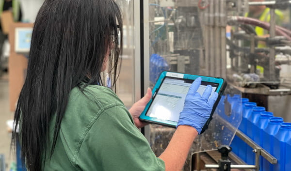 factory worker using a tablet on shop floor