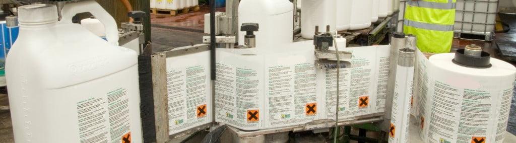 white UN jerrycans on a production line