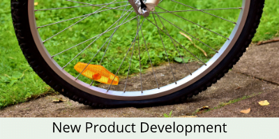 bicycle wheel in front of grass verge