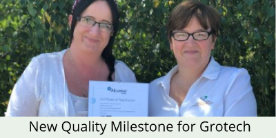grotech staff with ISO certificate